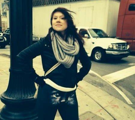Woman wearing cat leggings standing on street corner