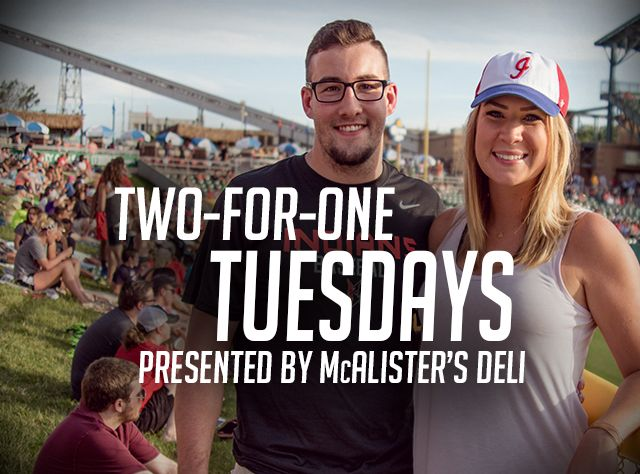 Couple smiling for a picture at concert with promotion for mcalister's deli