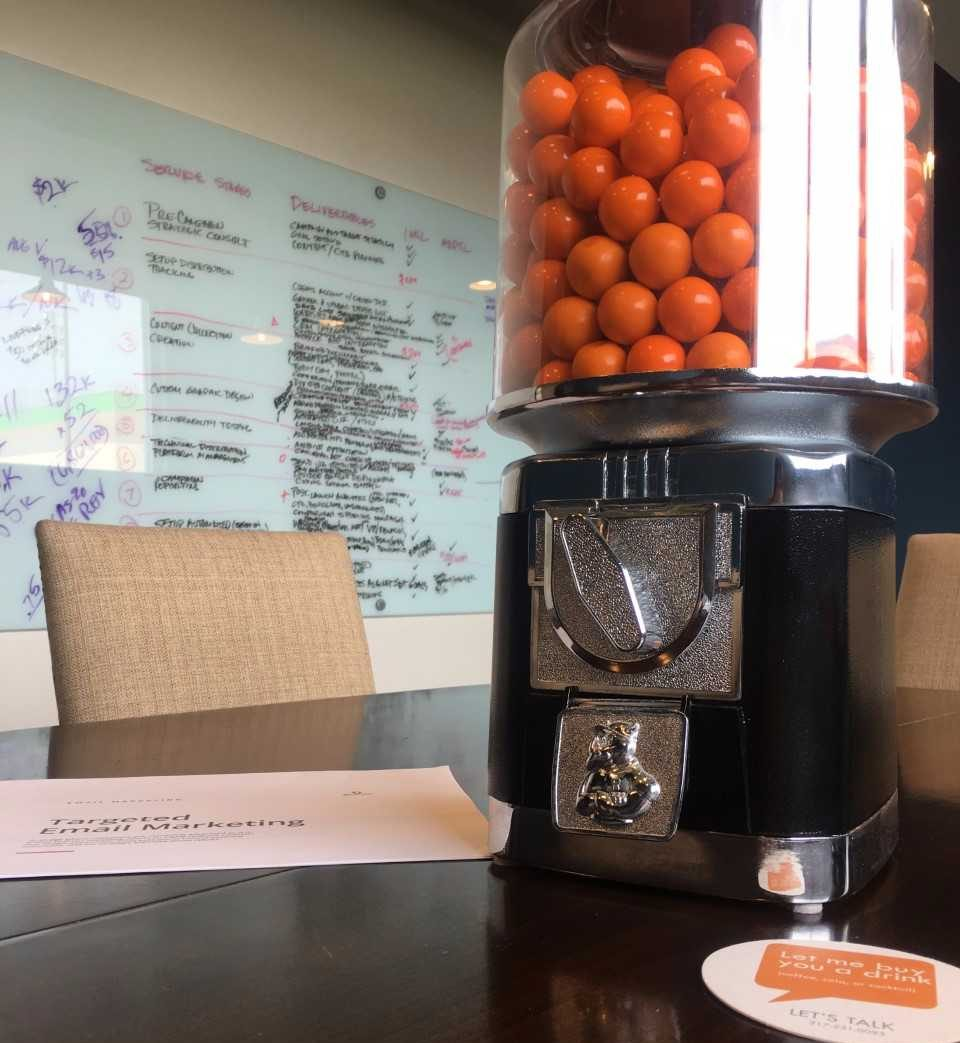 Gall Ball Machine on table in middle of meeting during fall internship at Burkhart Marketing