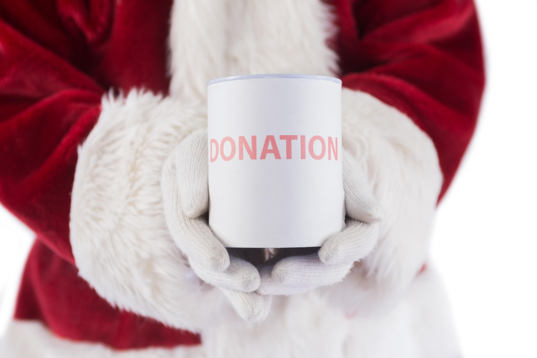 Santa clause holding a mug that says donation